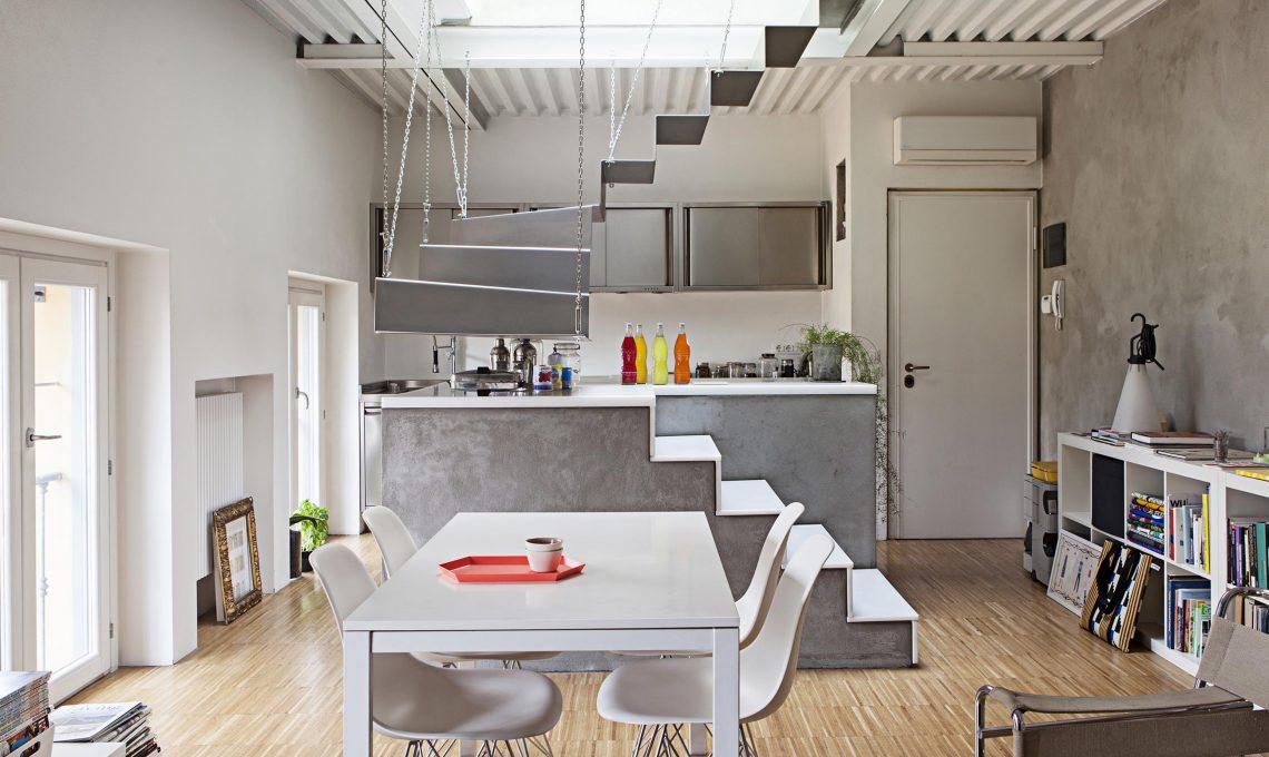 Acciaio cemento e legno nel recupero di un sottotetto for Cucine e salotti insieme