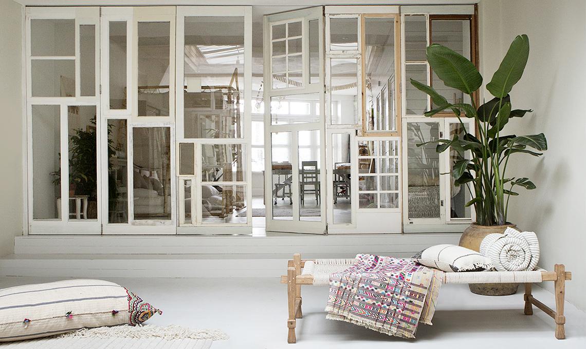 parete vetrata con finestre di riuso