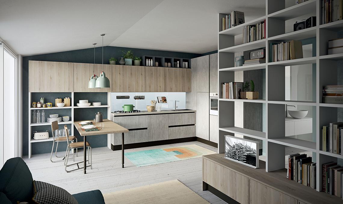 Nel monolocale la cucina a vista con scaffali e penisola for Idee cucina living