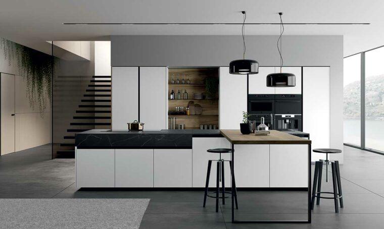 La polisensorialità del legno e la ricercatezza del vetro si incontrano nelle cucine di Arredo3